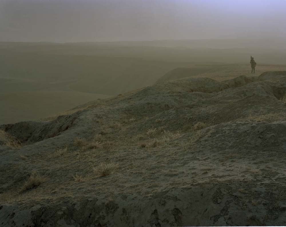 © Jo Röttger: Afghanistan, Mazar-e Sharif, Camp Marmal, Marmal Mountains, soldier in old combat trenches